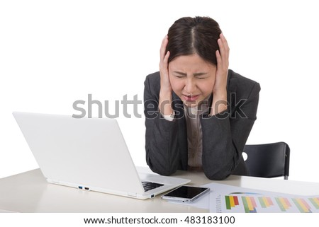 Worried business woman working with laptop on desk against white background.