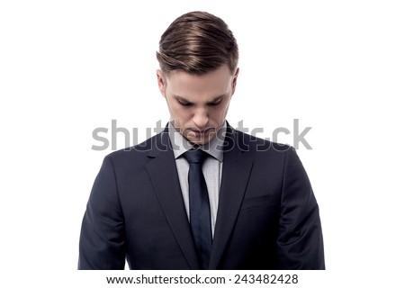Worried businessman bending head down - stock photo