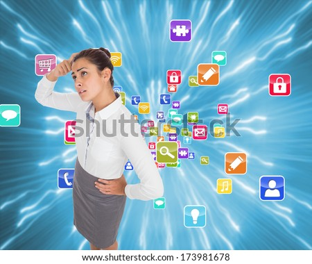Worried businesswoman against strands of blue lights - stock photo