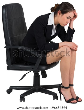 Worried businesswoman on swivel chair on white background - stock photo