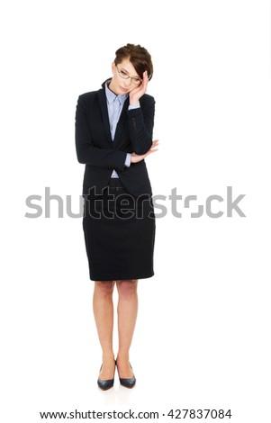 Worried businesswoman touching her head. - stock photo