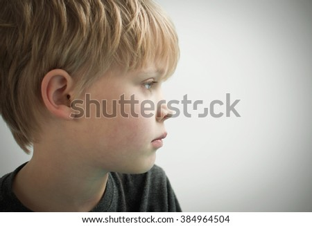 Worried child staring - stock photo