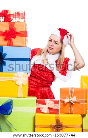 Worried Christmas woman looking at many presents, isolated on white background. - stock photo