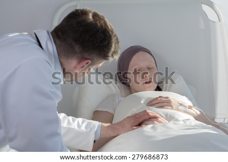 Worried doctor caring about young cancer woman