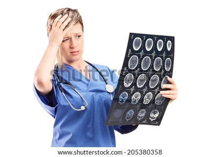 Worried female doctor looking at an x-ray isolated on white background - stock photo