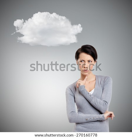 Worried look, isolated on grey - stock photo
