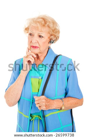 Worried looking senior woman talking on the hands free set for her cellphone.  Isolated on white. - stock photo