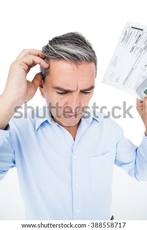 Worried man calculating tax on white background