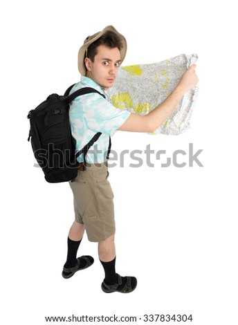 Worried man tourist in blue shirt, brown shorts and hat with backpack on his shoulders holding map. Traveler looking route and going to interesting tour. Isolated on white background.