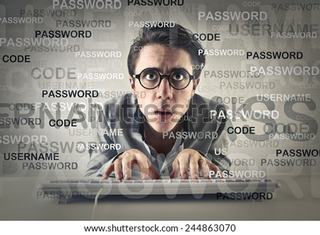 Worried man typing on the keyboard  - stock photo