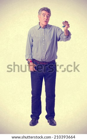 Worried man with a hourglass - stock photo