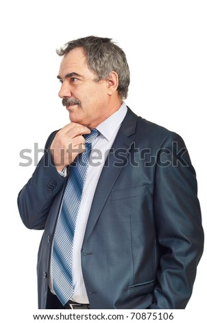 Worried mature business man thinking at solutions holding hand to chin and looking away isolated on white background - stock photo