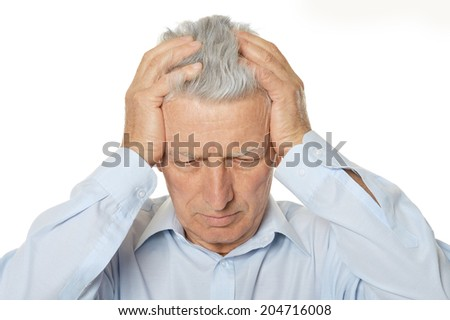 Worried mature man holding his head with hands