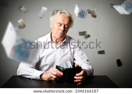 Worried old man in white is looking at a twenty euro and wallet. Accounting and taxes concept.