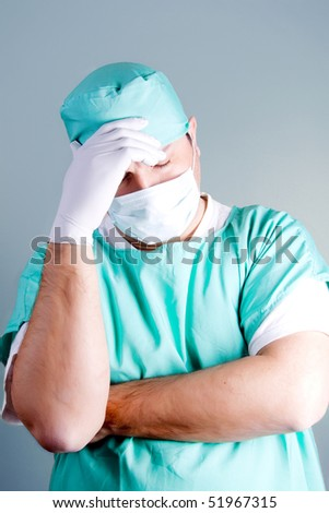 Worried or tired surgeon or an orderly