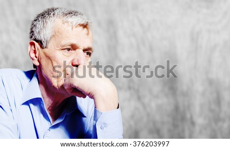 Worried senior businessman