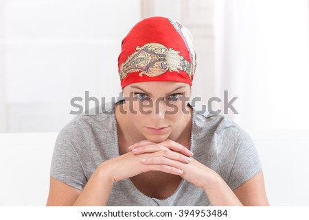 Worried sick woman with cancer at home  - stock photo