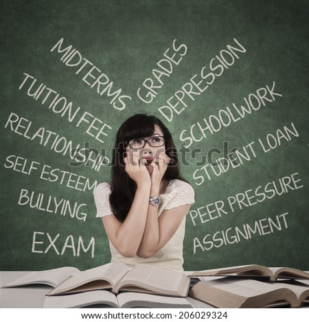 Worried student with cloud of her problems in the class - stock photo