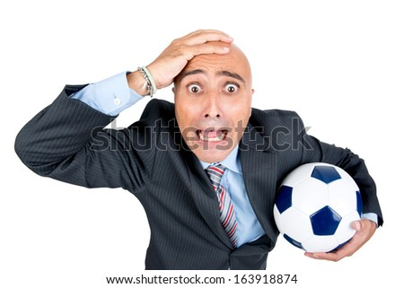 Worried supporter with soccer ball isolated in white - stock photo