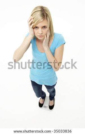 Worried Teenage Girl Standing In Studio
