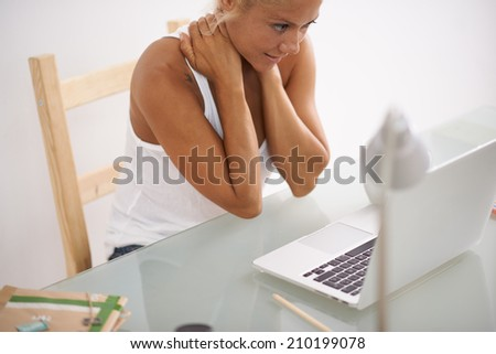 Worried woman doing some work in her desk - stock photo
