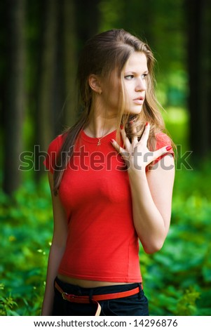 Worried woman in a forest. - stock photo