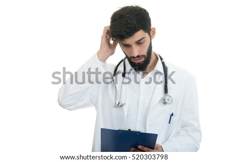 Worried young doctor with head in hand on white background