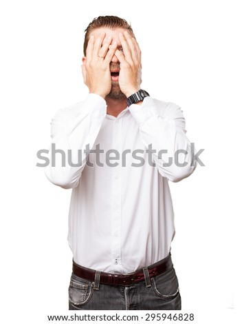 worried young man covering face - stock photo