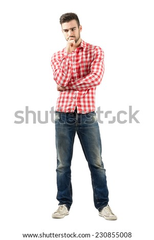 Worried young man in plaid shirt. Full body length portrait isolated over white background.  - stock photo