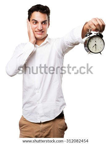 worried young man with clock