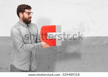 worried young man with magnet - stock photo