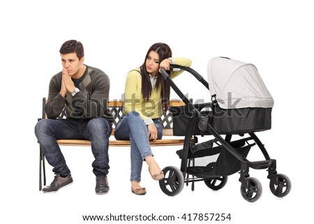 Worried young mother and father sitting on a bench and contemplating isolated on white background - stock photo