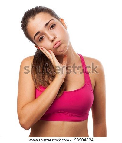 Worried young sporty woman isolated on white - stock photo