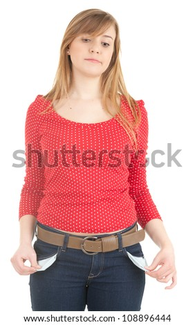worried young woman showing she has no money by turning out her pockets, white background