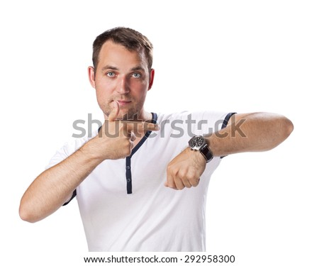 Worrier man running out of time looking his watch isolated on a white background