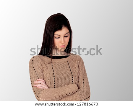 Worry teenager isolated on a grey background - stock photo