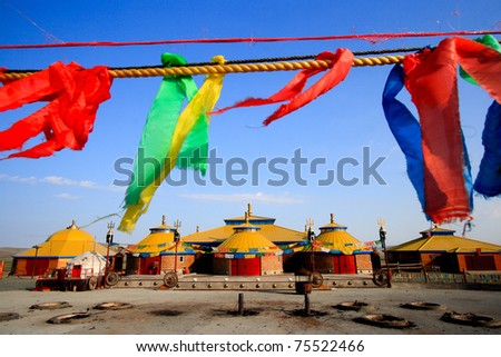 Worship place at Inner Mongolia with hanging colorful stripes in the foreground. - stock photo