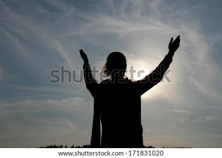 worship the sun. - stock photo