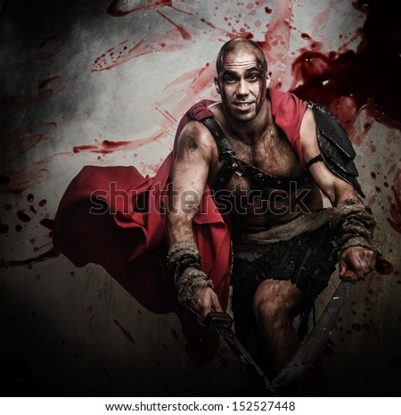 Wounded gladiator attacking with two swords - stock photo