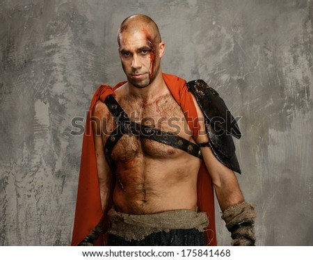Wounded gladiator close-up - stock photo