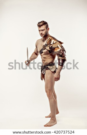 Wounded gladiator holding short sword - stock photo