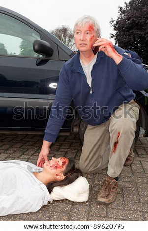 Wounded man calling for help after a car accident - stock photo