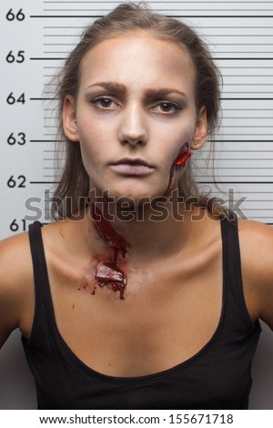 Wounded woman have snapshot in police department. Realistic bloody wound and bruises - stock photo