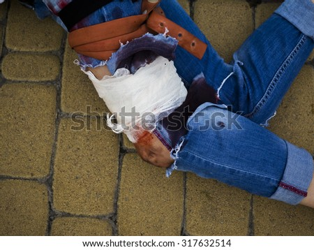 wounded woman lying on the ground - stock photo