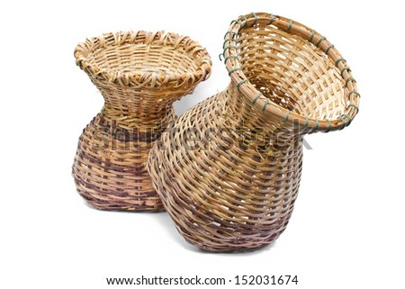 Woven bamboo container on a white background.