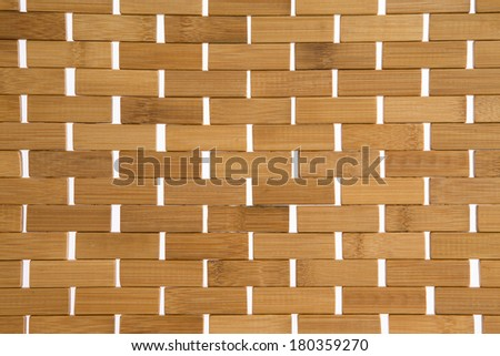 Woven bamboo mat background texture with white weave detail showing the natural fibers of the bamboo, full frame - stock photo