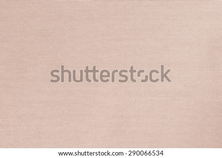 Woven cotton fabrics textile textured background in light orange brown beige color tone     - stock photo