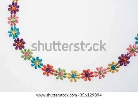Woven flowers on a white background - stock photo