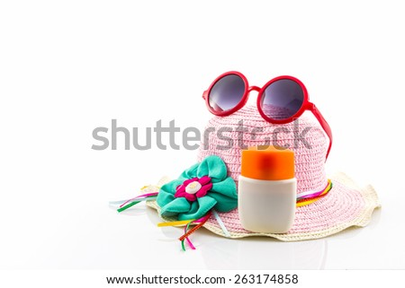 Woven hat with body lotion and red sunglasses on white background. - stock photo