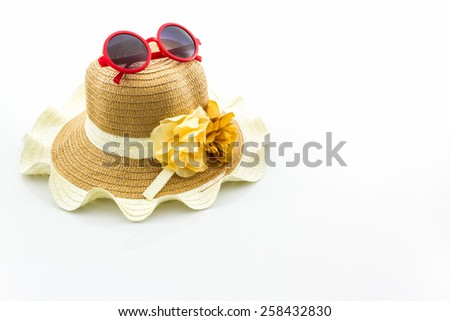 Woven hat, with red sunglasses on white background. - stock photo